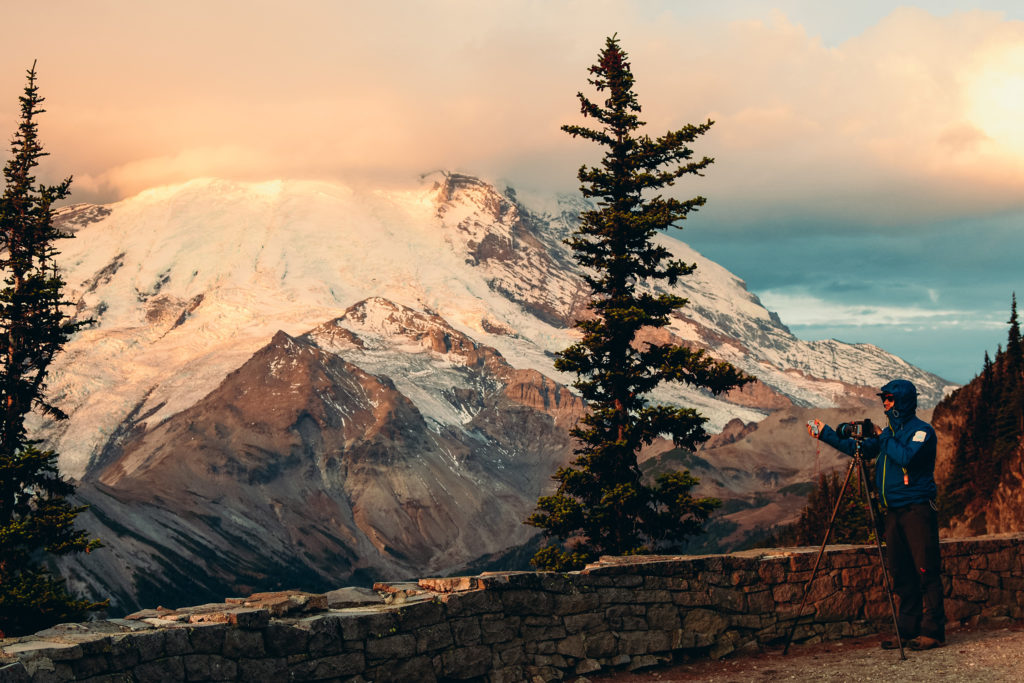 Artist Peter Funch photographingEmmons glacier on Mt. Rainier from the Burroughs Mountain Ridge.